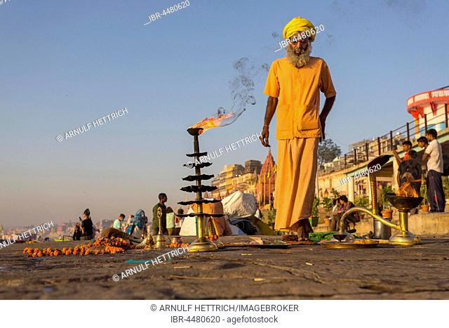 Spiritual morning prayer on the Ganges, Varanasi, Uttar Pradesh, India