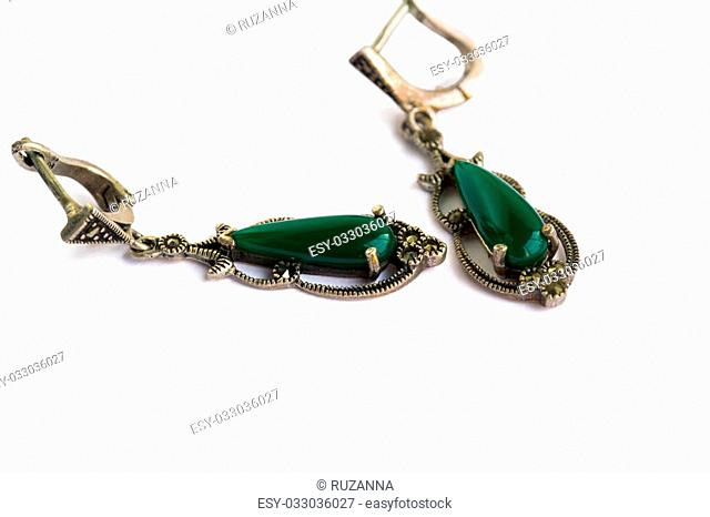 Earrings with natural green stones isolated on white background