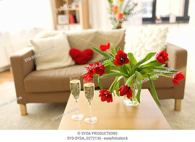 champagne glasses and flowers on valentines day