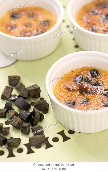 Creme brulee. Sweet french dessert served with liquorice in bowl