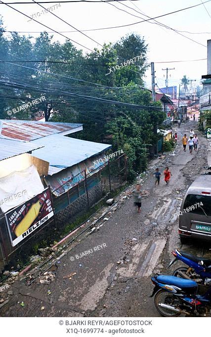People walking along a sidestreet  Lapu-Lapu City, Metro Cebu, Mactan Island, Visayas, Philippines