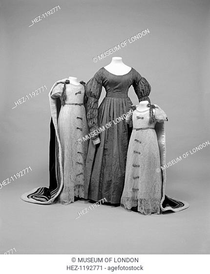 Queen Victoria's Accession Dress 1837 flanked by the Queen and Princess Magaret's Coronation Dresses, 1937