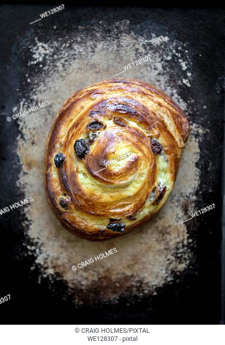 Pain aux raisins breakfast pastry. A breakfast food often eaten in France that is directly translated to raisin bread