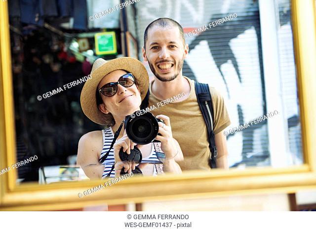 Greece, Athens, happy tourists visiting Monastiraki Flea Market