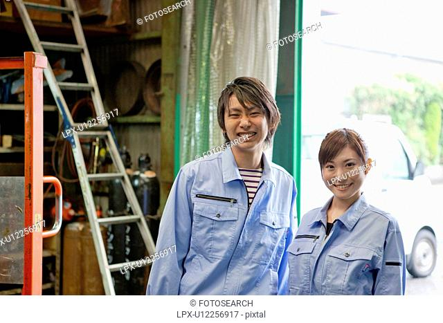 Portrait of Two Factory Workers
