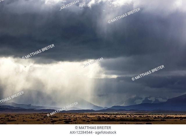 Rain clouds over Seno Ultima Esperanza and Cerro Monumento Morre near Puerto Natales; Magallanes region, Chile