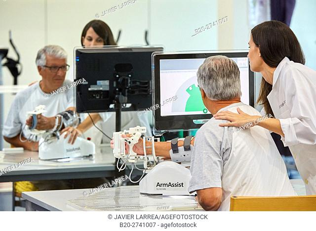 Therapist and patient with assistive robot for upper limb rehabilitation, The robot ArmAssist allows passive, assisted and active training of the arm and hand