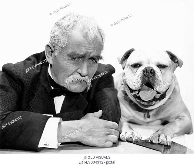 Portrait of man and dog All persons depicted are not longer living and no estate exists Supplier warranties that there will be no model release issues