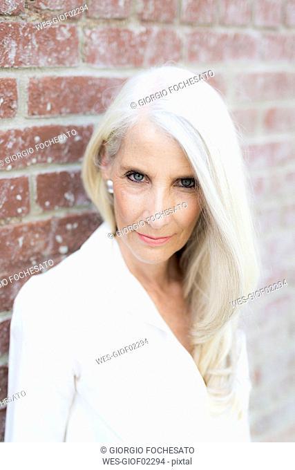 Portrait of mature woman wearing white blouse