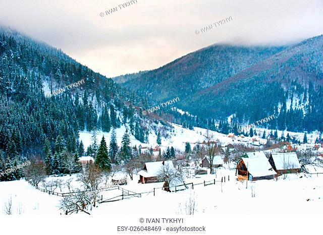 Transcarpathians village in the mountains covered by snow. Ukraine