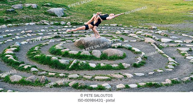 Acrobats performing on stone arrangement, Bainbridge, Washington, USA