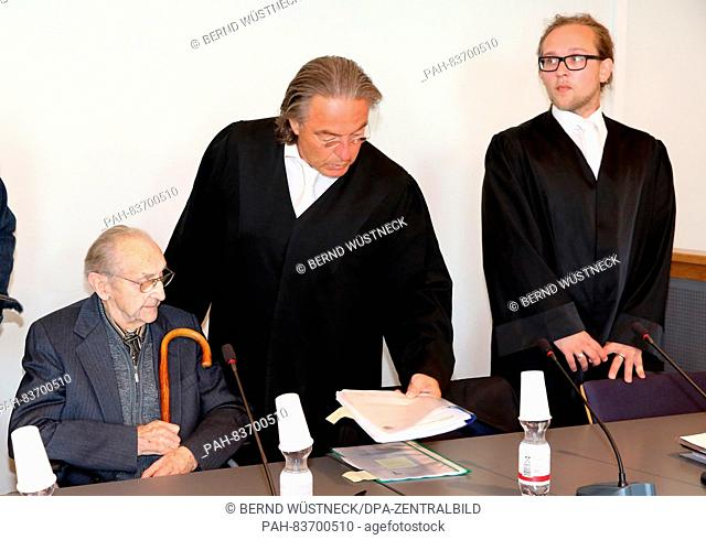 Ahead of the trial against the former SS medic Hubert Z. (L) 71 years after the end of WW2, the 95-year-old defendant waits with his lawyers (L-R)Peter-Michael...