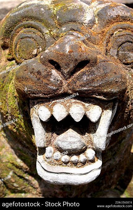 Face with teeth in balinese temple, Tirta Empul, bali