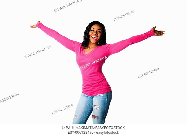 Beautiful happy smiling young woman with open arms welcoming celebrating cheering, isolated