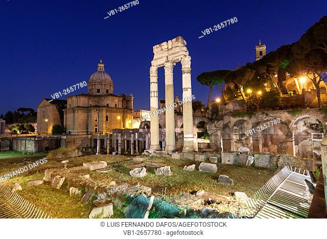 Temple of Venus Genetrix at the Forum of Caesar at dusk, Santi Luca e Martina Church in background, Rome, Italy