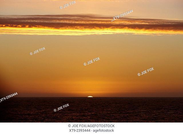 sun setting over the antarctic ocean Antarctica