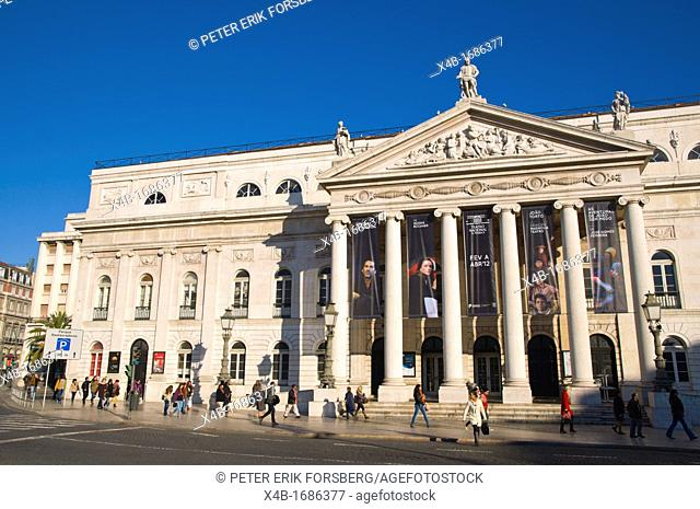 People walking in fron of the opera house at Rossio square Baixa district central Lisbon Portugal Europe