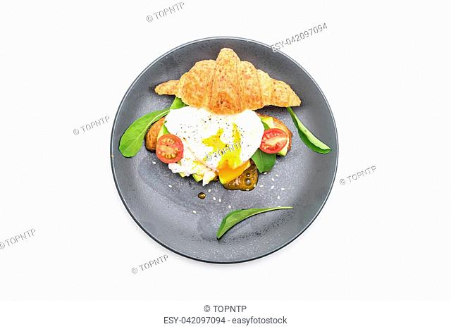 egg benedict with avocado, tomatoes and salad - healthy or vegan food style - isolated on white background