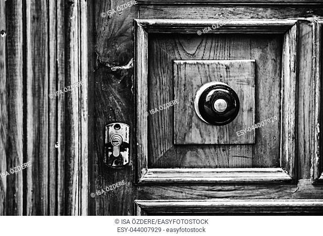 Architectural detail of a vintage, rustic door handle ,vintage antique door handle on the old wooden door. Metal handle and lock