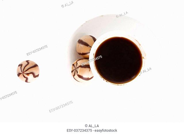 White coffee cup with tasty sweets isolated