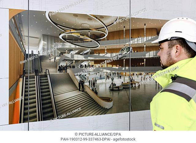 11 March 2019, Hamburg: Site manager Maik Hauer looks at an illustration of the newly built foyer of the Congress Centre Hamburg, CCH