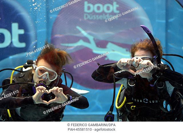Divers pose for the photographers in Duesseldorf,Germany, 17January 2014. Around 1,650 exhibitors from 60 countries are taking part in the expo boot...