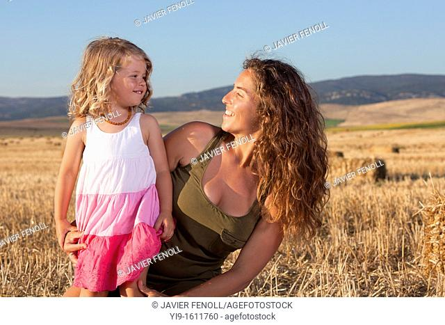mother and daughter in the field