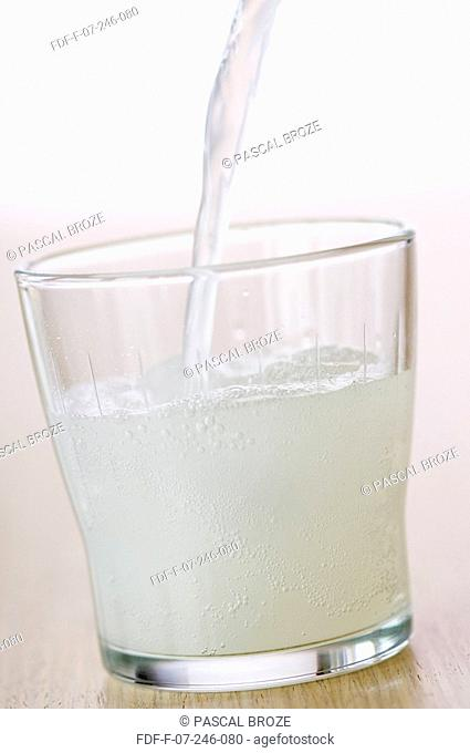 Close-up of soda being poured in a glass