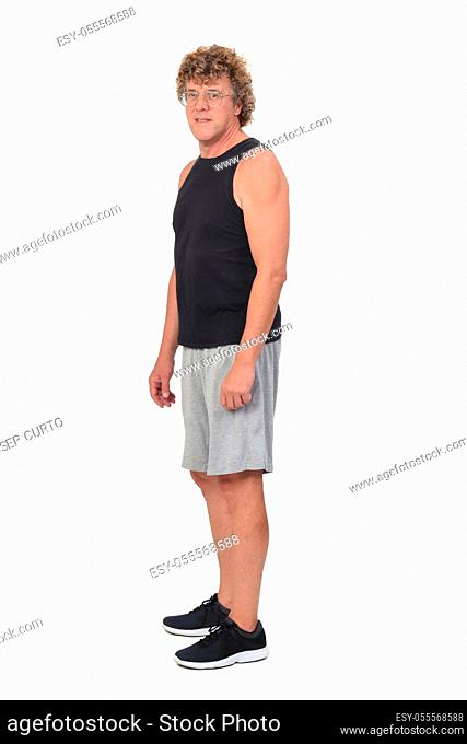 portrait of a man wearing sportswear tank tops and shorts on white background