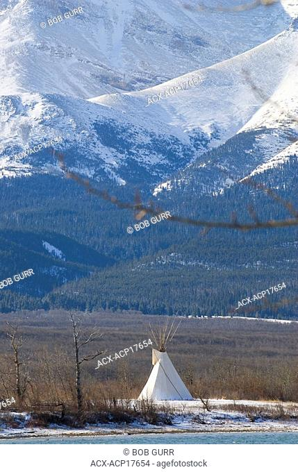 Tipi with Vimy Ridge and Sofa Mountain in background, Waterton Lakes National Park, Alberta, Canada. A conical tent originally made of animal skins or birch...
