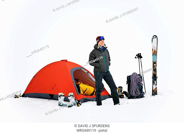 A happy mountaineer ski tourer at base camp