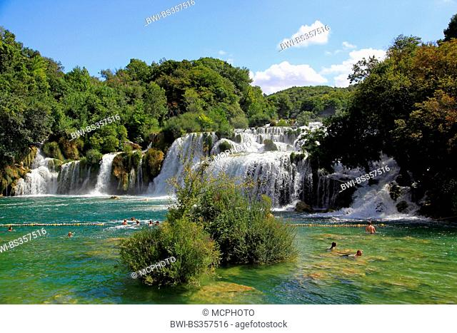 bathing people in Krk river under Skradinski buk waterfalls, Croatia, Dalmatien, Krka National Park