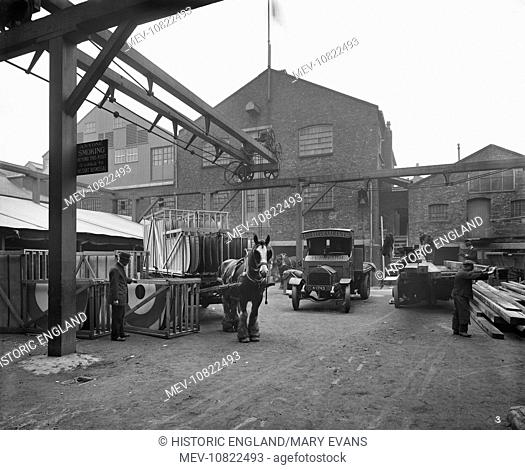 Trollope And Colls Limited, 17-25 Pleasant Street, Liverpool. Exterior view of the yard with motor lorries and horse and cart loaded with aeroplane wings
