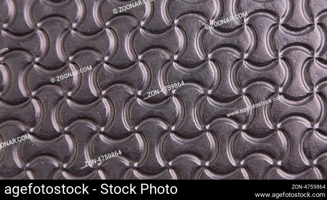 Black background with a pattern of stylized infinity