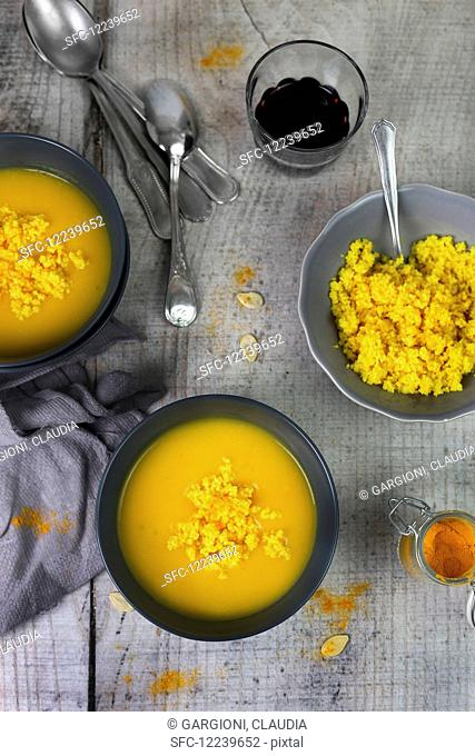 Cream of pumpkin soup with turmeric couscous