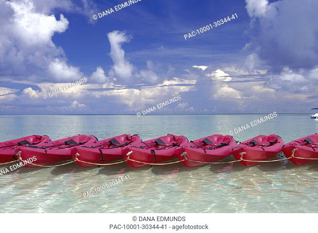 Guam Tumon Bay many pink kayaks lined up tied together shallow ocean D1221