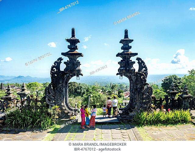 Young Balinese women at the gateway to a temple, Mother temple, Besakih temple, Pura Penetaran Agung Besakih, Bali Hinduism, Banjar Besakih, Bali, Indonesia