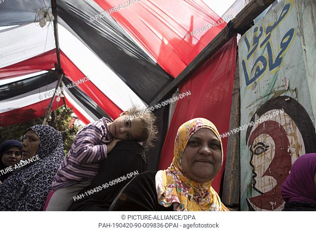 20 April 2019, Egypt, Cairo: Women stand in lines to take part in the first day of the national referendum on the constitutional amendments extending the...