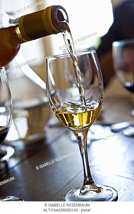 Pouring glass of white wine