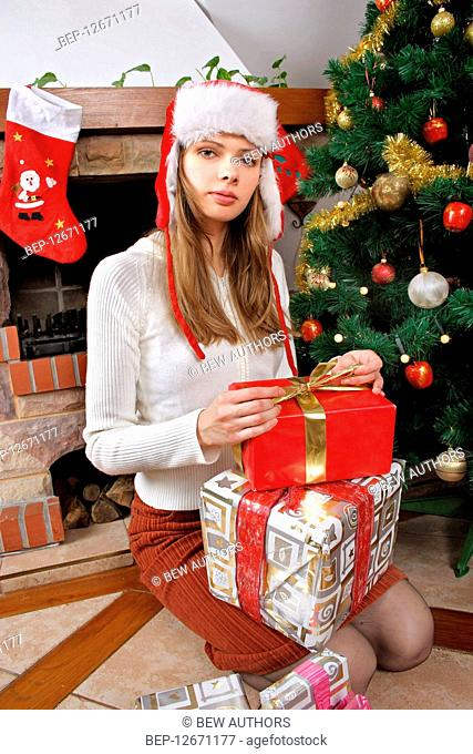 Girl with gift on Christmas Eve