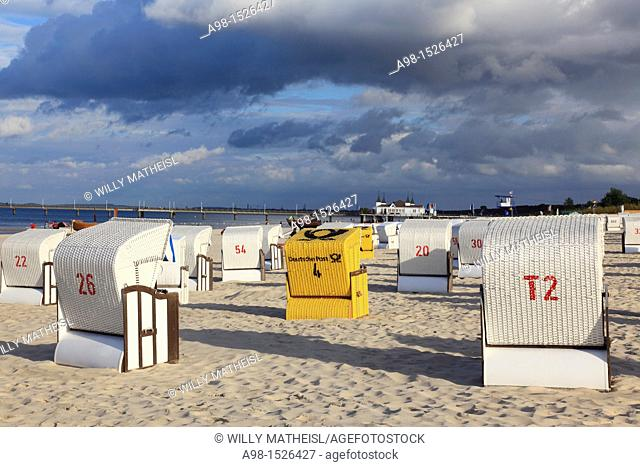 roofed wicker beach chair at the sandy coast of the isle of Usedom, Western Pomerania, Germany, Europe