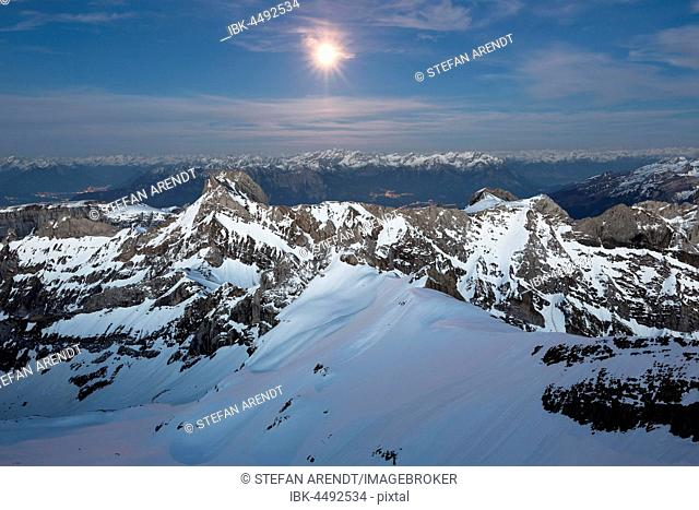 Säntis Mountain overlooking Alpstein massif at full moon, Appenzell Alps, Appenzell, Switzerland