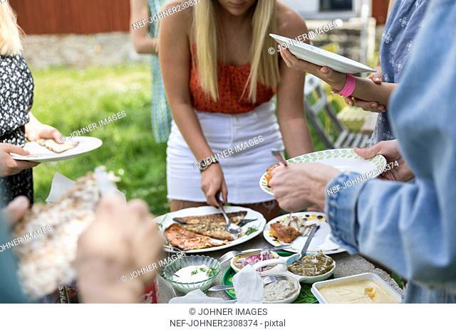 People having food outside