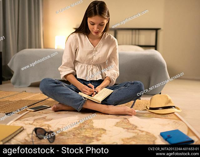 Young lady planning journey near map