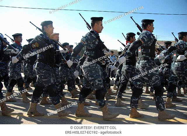 Iraqi police officers march during a parade in their honor near the in Nasiriyah Iraq. Jan. 9 2010. BSLOC-2011-12-150