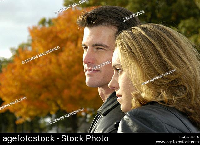 Young adult male and female couple in a loving passionate relationship