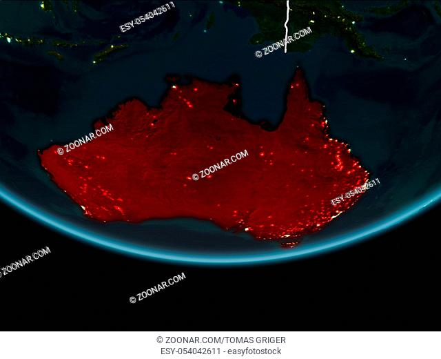Australia highlighted in red on planet Earth at night with visible borders and city lights. 3D illustration. Elements of this image furnished by NASA