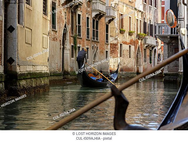 Gondolas on canal waterway, Venice, Veneto, Italy
