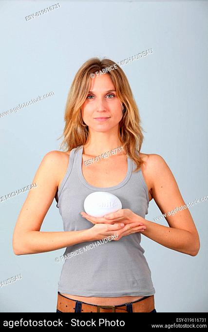 Woman holding stone with message