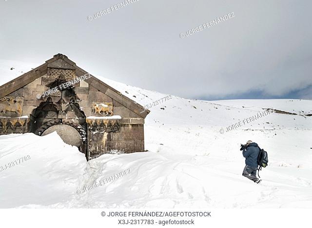 Man photographing the ruins of a church, Armenia